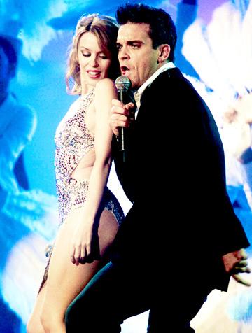 Robbie Williams amuzat de goliciunea lui Kylie Minogue