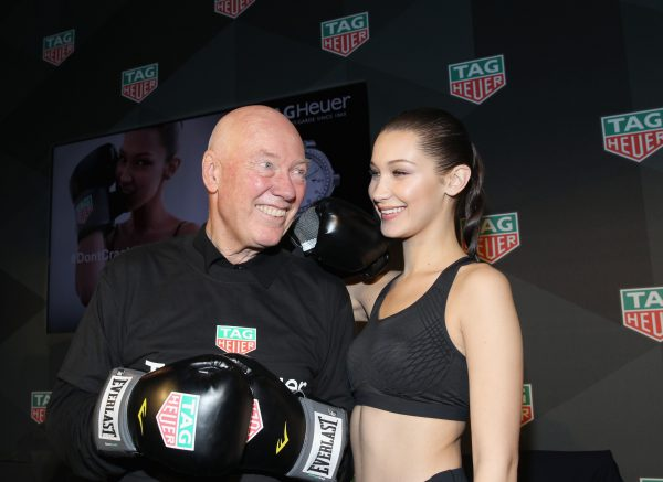 NEW YORK, NY - FEBRUARY 13: CEO of TAG Heuer Jean-Claude Biver (L) and Bella Hadid pose during A Fresh New Face For TAG Heuer at Equinox Bond Street on February 13, 2017 in New York City. (Photo by Bennett Raglin/Getty Images for TAG Heuer)