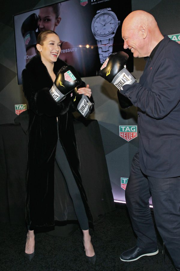 NEW YORK, NY - FEBRUARY 13: Bella Hadid (L) and CEO of TAG Heuer Jean-Claude Biver pose during A Fresh New Face For TAG Heuer at Equinox Bond Street on February 13, 2017 in New York City. (Photo by Bennett Raglin/Getty Images for TAG Heuer)